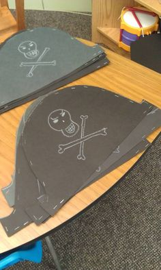 Teachers could print the skull and cross bones. Children could cut and glue, then use white crayon or chalk to decorate the rest of the hat!