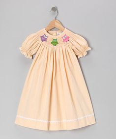 As timeless as it is effortless, this beautiful bishop-style dress slips right on with its elastic-hemmed sleeves and boasts beautiful embroidery along the smocked neckline.