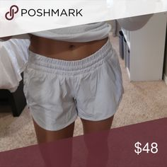 Lululemon tracker shorts In perfect condition white lululemon tracker shorts. Bought these in summer 2016. I forgot to take a picture of them off, front and back, but there are no stains or snags! I can pull them out and take picture on my iPhone lululemon athletica Shorts Skorts