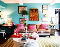 Hot pink details and turquoise walls brings unorthodox cool to traditional furniture. Large scale neutrals in quiet textures ground the voice of bold prints and wild colors.