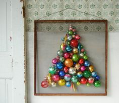 New uses for old ornaments:   Instead of placing ornaments on a tree, why not make a tree out of ornaments? This clever, adorable craft, courtesy of Amy from Into Vintage, makes great use of clearance-sale ornaments and an old window screen.