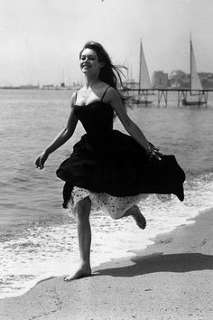 Could anyone look chicer than Brigitte Bardot running barefoot in Cannes?