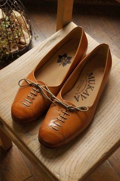 tan lace-up flats