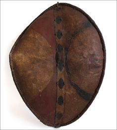 War shield, Masai, Kenya.  This is a rare and old Maasai painted war shield. It is made from thick hide stretched over a wooden frame and is...