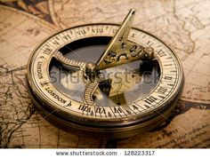 old compass on vintage map 1752 by Triff, via ShutterStock