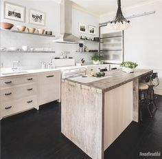 """An 1896 Victorian Kitchen Gets a Modern Update  - HouseBeautiful.com Love the """"dovetailed"""" island and vintage stove."""