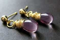 Gold wire wrapped stud earrings in glass