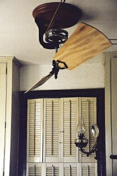 Belt-driven ceiling fan with solid-mahogany blades by Woolen Mill Fan Co., New Park, PA.