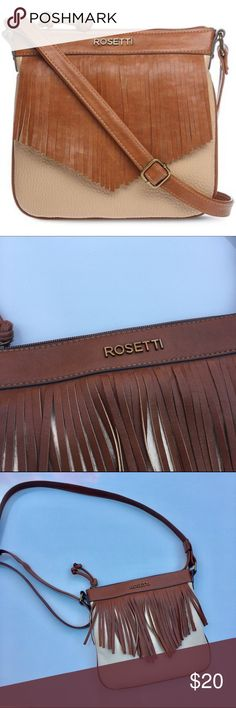 "Rosetti Fringe Handbag Tapered, chestnut fringe frames the front of this small but mighty bohemian mini crossbody bag. Crossbody strap, 24"" drop top zipper closure with knotted toggle synthetic; polyester lining bronze-tone metal hardware exterior back zipper pocket interior zipper pocket and 2 slip pockets 8½(H) x 9(W) x ¾""(D). Great condition! Bundle 2+ and save an extra 20%! Rosetti Bags Crossbody Bags"