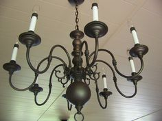 shiny brass to antiqued patina bronze -- Trash to Treasure Decorating: Yard Sale Chandelier Makeover