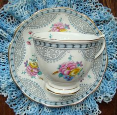 Royal Albert Bone China England - Vintage Tea Cup and Saucer, Multifloral with a Grey and Blue Design by OfftheShelf2015 on Etsy