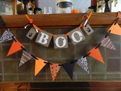 Gorgeous Halloween garland in oranges and black - great look for any mantle!