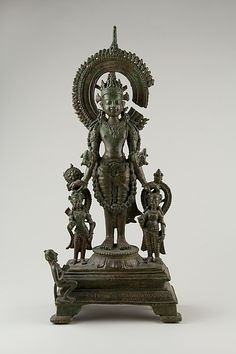 "Vishnu Flanked by His Personified Attributes, early 9th century. India (Bihar). The Metropolitan Museum of Art, New York. Gift of Florence and Herbert Irving, 2015 (2015.500.4.10) | This work is exhibited in the ""Encountering Vishnu: The Lion Avatar in Indian Temple Drama"" exhibition, on view through June 5, 2016. #AsianArt100"