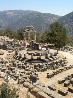 The remains of the Tholos in the Sanctuary of Athena, Delphi, Greece.  It was a circular building that was constructed between 380 and 360 BC.  It consisted of 20 Doric columns arranged with an exterior diameter of 14.76 meters, with 10 Corinthian columns in the interior.  by tjensen99