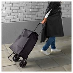 KNALLA Shopping bag on wheels, black. KNALLA series has you covered when it comes to shopping, visits to the gym and outings. Bags, seat pad and rain gear make every day on the go smoother and make sure surprise showers won't dampen your day. Folding Shopping Cart, Shopping Bag, Recycling Station, Rolling Bag, At Home Furniture Store, Rain Gear, Key Hooks, Seat Pads, Backpack Bags