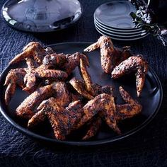 """HALLOWEEN - While chicken wings aren't inherently creepy, once fried and glazed with a Chinese black-bean sauce and arranged to appear in-flight, they convincingly become """"bat wings."""" Recipe: Fried Chicken Wings with Black Bean Sauce Halloween Chic, Halloween Food For Party, Halloween Ideas, Halloween Goodies, Adult Halloween, Halloween 2019, Happy Halloween, Sauce Recipes, Wine Recipes"""