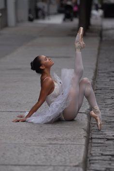 A nice ballet dancer hailing a taxi...