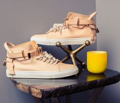 The Best Designer Sneakers Featured By Coveteur: Tan Leather Mid Height Sneakers with White Sole and Gold Accents | coveteur.com