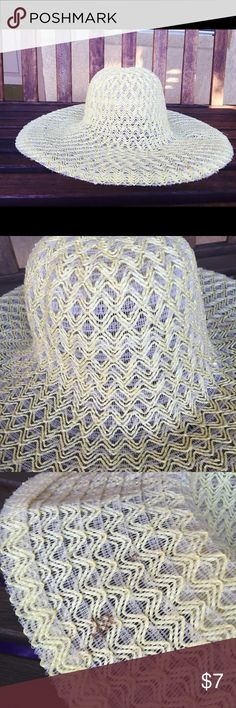 Yellow Floppy Hat Yellow straw like hat with a wide brim to keep the sunshine off your face. Does have some brown spitting on the inside (see photos) but that's it. Accessories Hats