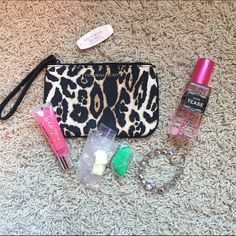 VS Tease Bundle Includes. NWT cheetah wristlet, VS NWOT Tease perfume, love berry beauty rush lipgloss NWT, New sample of Lush green fun & new sample of Lush you've been mangoed PINK Victoria's Secret Bags Cosmetic Bags & Cases