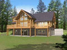 Marvin Peak Log Home Soothing Wall of Windows Grace This Log Homes Exterior from houseplansandmore.com