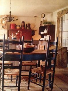 Almost exactly my chairs, that were my grandmother's chairs. I remember being able to hold the bottom rung & dance :) Primitive Dining Rooms, Country Dining Rooms, Primitive Kitchen, Primitive Furniture, Woven Dining Chairs, Table And Chairs, Tables, Prim Decor, Country Decor