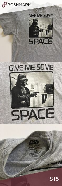 "Star Wars size XXL Graphic Tee Shirt Star Wars men's graphic tee with Darth Vader and Princess Leia.   Fabric: 90% Cotton / 10% Polyester  Color: Gray with black and white graphic  Details: Basic gray tee shirt with Star Wars graphic. Graphic had Darth Vader and Princess Leia on it with the saying ""Give me some space"" around it.   Condition: Great condition. Like new. Graphic is in perfect condition. No holes, stains, or flaws in fabric. Comes from a smoke free home. Measurements laid flat…"