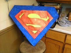 Homemade superman piñata for a superhero party