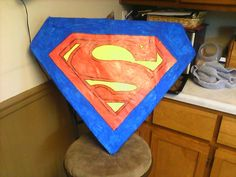Homemade superman piñata for a superhero party