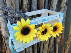 """Rustic Wooden Sunflower Crate, Sunflower Wedding, Blue and White Crate,Nautical Decor,Beach Wedding Decor, Home Decor, Country Wedding      Distressed white and blue wooden crate, adorned with three sunflowers in front this crate would be a great addition to any blue and yellow wedding!       This wooden box is entirely handmade, handtpainted.      Measurments: 20 x 12 cm or apprx. 8"""" x 5""""            Find the matching decoration here:      White & Blue Rustic Nautical Wicker Heart…"""