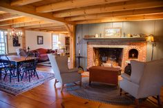 Sit and enjoy the fire, and Television witht he family. The beauty of the open floor plan. www.earlynewenglandhomes.com