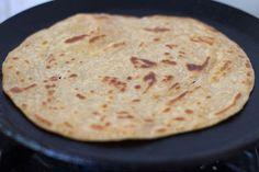 frying kerala paratha or kerala parotta