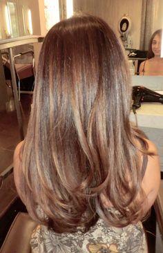 Shiny brunette, fine highlights. Color by Neil George Salon colorist Kazumi Morton.