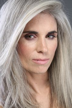 silver hair - brown eyes. so many of the pictures, the models are blue eyed.