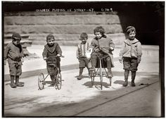 Children playing on the street somewhere in New York City. April 2, 1909. 5x7 glass negative, George Grantham Bain Collectio...