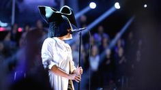 """Sia sings """"Alive"""" on The Voice stage."""