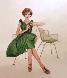From The Nifty Fifties - Model wearing a green, striped sundress for Vogue, 1958.