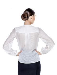 A crisp white blouse, cut from a silk and cotton blend squared design fabric with bell cuffed sleeves and a mandarin collar make this a polished option for your work day. Fabric imported from Hong Kong: 64% Silk 36% Cotton Washcare: Dry clean MADE IN EUROPE