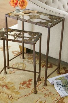Avalon Iron Nesting Tables | The scrolled cast iron detail of this glass topped table borrows its design from the intricate ironwork found on a French window box. Finished with rivet trim and an oxidized rust patina. |