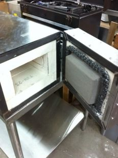 Homemade heat treating oven constructed from angle iron, sheetmetal, and firebricks. Equipped with a PID temperature controller, 2 solid state relays, and nichrome heating elements