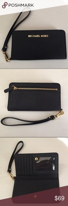 Micheal Kors smartphone wristlet. Like new!  Authentic Micheal Kors black smartphone wristlet. Like new! No scratches or stains. Fits iPhone 6 even if your phone has a protective slim case. It has 5 credit card slots and an ID slot. Very little wiggle room with price. Remember to bundle and save 10% on 2 or more items  Michael Kors Accessories Phone Cases