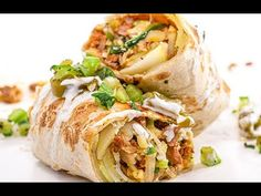 Chorizo, peppers & potatoes come together for a crispy burrito that's served with crema + a fresh tomatillo salsa. Pickled Jalapeno Peppers, Stuffed Poblano Peppers, Mexican Dishes, Mexican Food Recipes, Mexican Meals, Burritos, Food Network Recipes, Cooking Recipes, Skillet Recipes