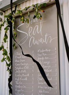 Photo: Sylvie Gil; unique wedding reception seating chart idea
