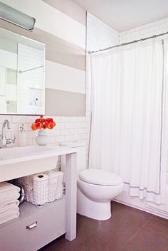 Home Tour: A Stylish, DIY-Filled Family Home// gray bathroom, stipe walls