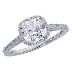Cushion Cut Halo Engagement Ring with .71 ct center diamond | bridesandrings.com