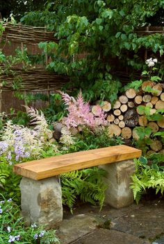 Stone & wooden bench on patio in backyard garden, with flowers, | Plant & Flower Stock Photography: GardenPhotos.com