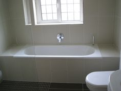 Bette Starlet bath fitted wall to wall filled by Hansgrohe Metris mixer. This gives a clean, simple line to the space.