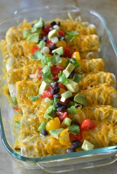 2 large avocados, diced 3/4 cup canned black beans, drained and rinsed 1 1/2 cups grated sharp cheddar, divided 1 small red bell pepper, diced 1/2 teaspoon kosher salt 1/2 teaspoon ground cumin 1/2 teaspoon garlic powder 10 corn tortillas 12 oz green enchilada or chili verde sauce (Trader Joes is my favorite)
