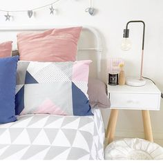 New pastel pink, grey and navy bedlinen styled with marble and copper Marlo lamp | Our Urban Box