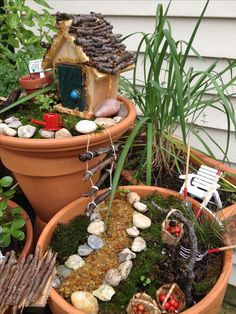 Landscape design ideas- for the backyard;  Cute idea to make fairy garden containers connect!
